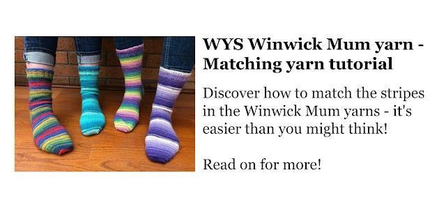 Four pairs of socks in Winwick Mum yarn modelled on feet