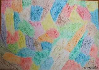 kartka pokolorowana w barwne plamy kredkami świecowymi