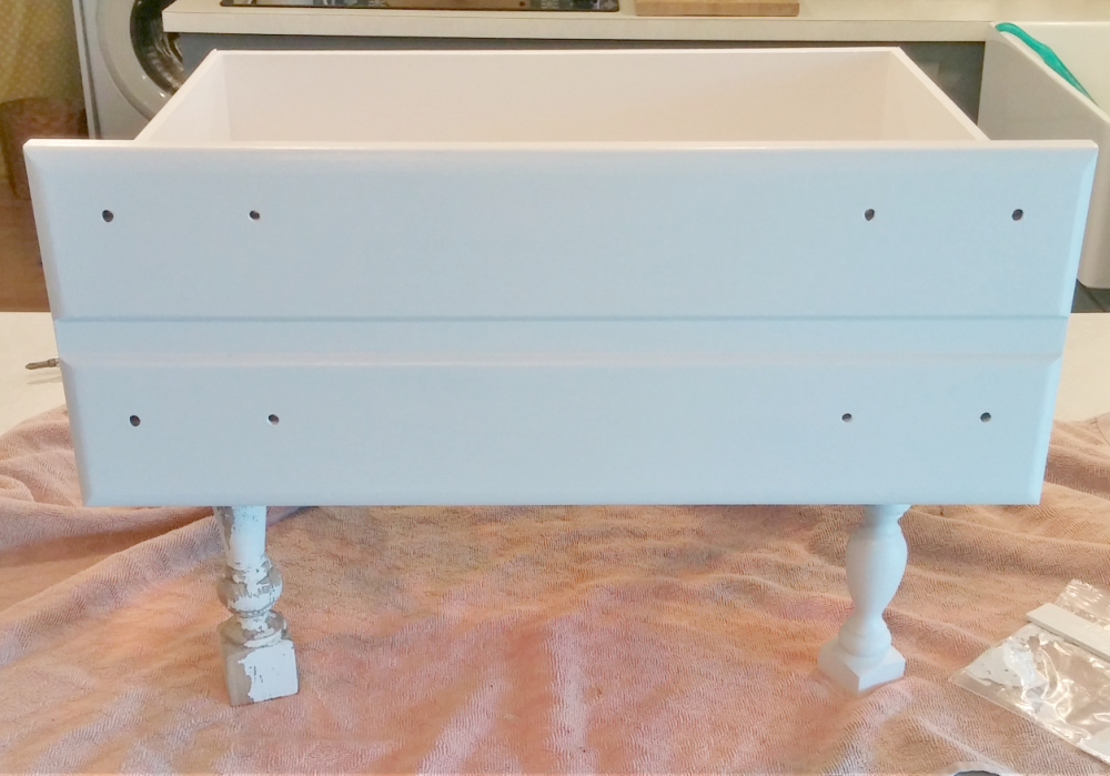 paint the drawer with a second coat of paint
