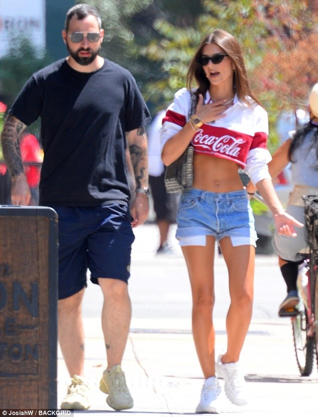 Emily Ratajkowski flashes sculpted midriff in crop top as she strolls in NYC