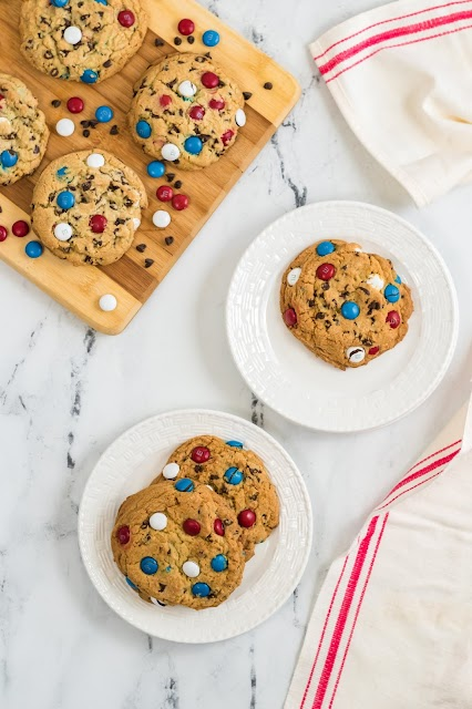 cookies on white plates and wooden board