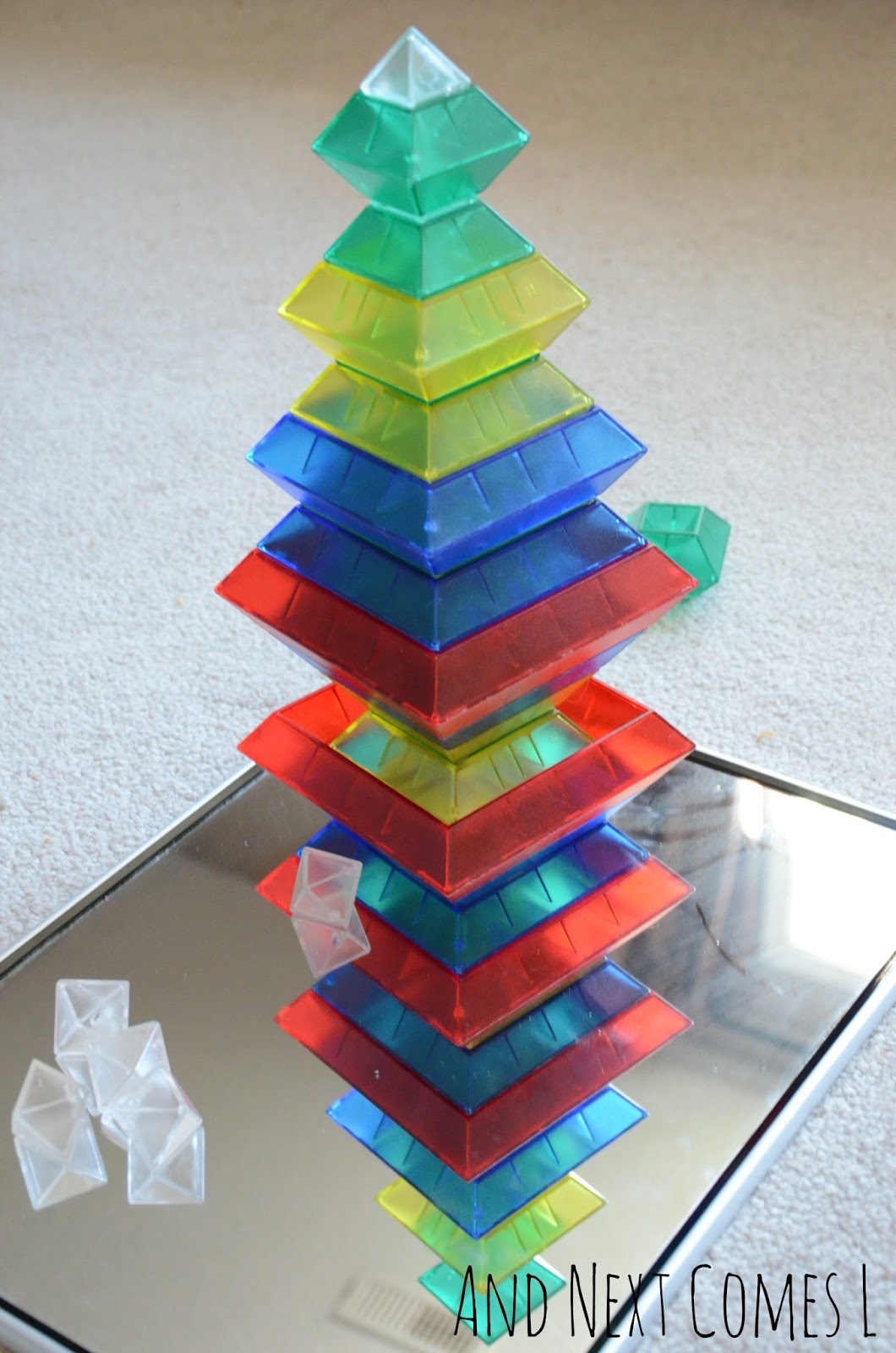 A tower of translucent WEDGiTS on a mirror from And Next Comes L