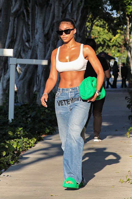 Lori Harvey flaunts her abs while shopping on Melrose Place in West Hollywood in a sports bra and trousers Actress Trend