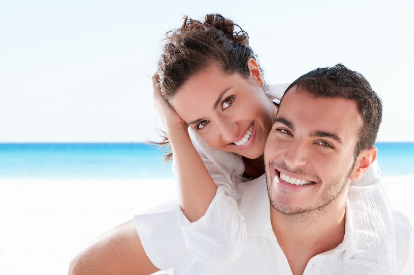 Have a beautiful smile like this couple on the beach and stop smoking. Call your dentist in Beverly Hills for help.