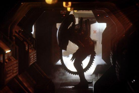 Alien in ships corridor in silhouette in Alien 1979