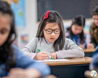A student working quietly at their desk.
