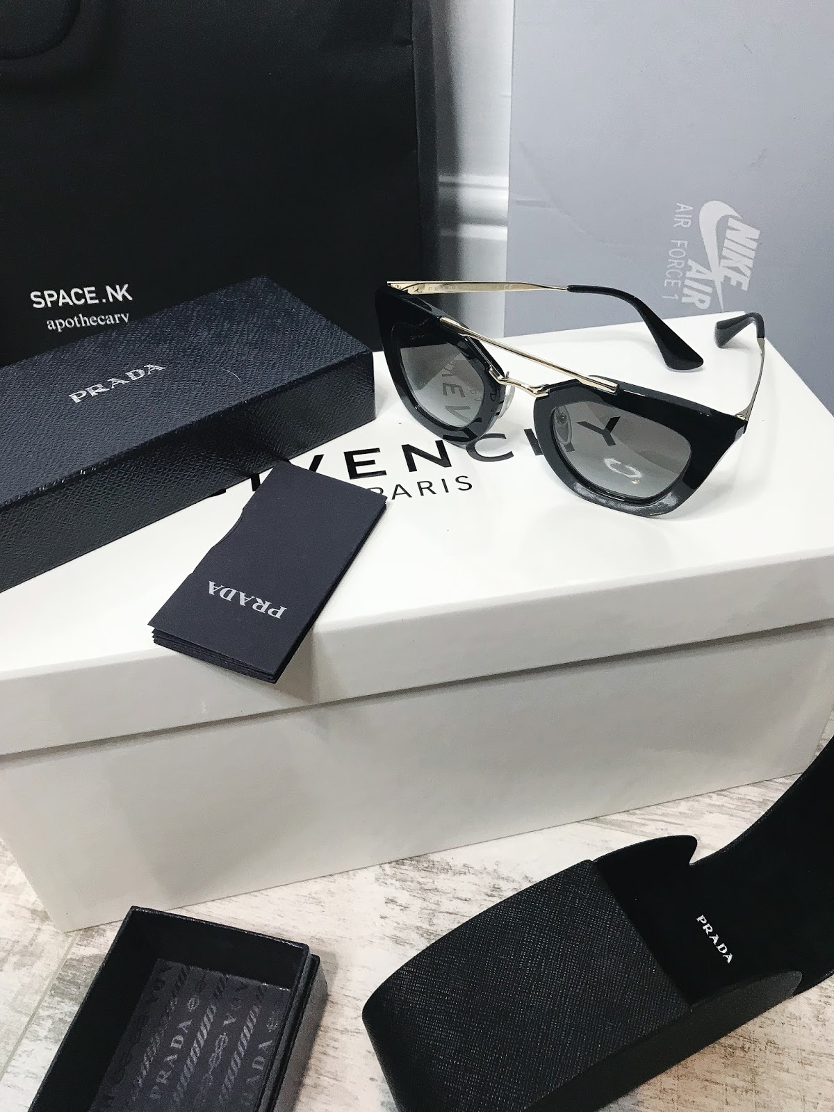 Prada cinema sunglasses black and gold