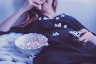 a person eating popcorn | Hearing aid near Alma MI