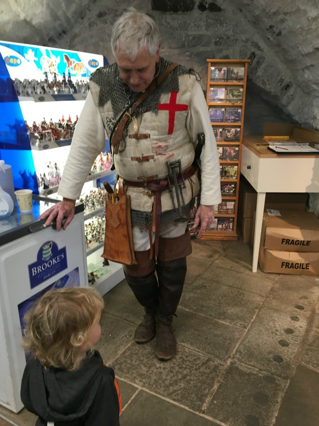 toddler talking to man dressed as a medieval knight