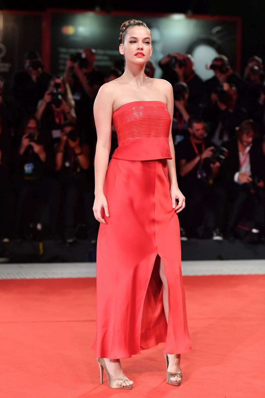 Barbara Palvin is radiant in red as she arrives for the premiere of Seberg during the 2019 Venice Film Festival