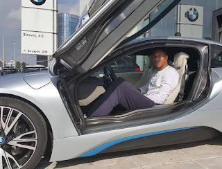 Mariah Riddlesprigger's boyfriend Giannis Antetokounmpo sitting in a car