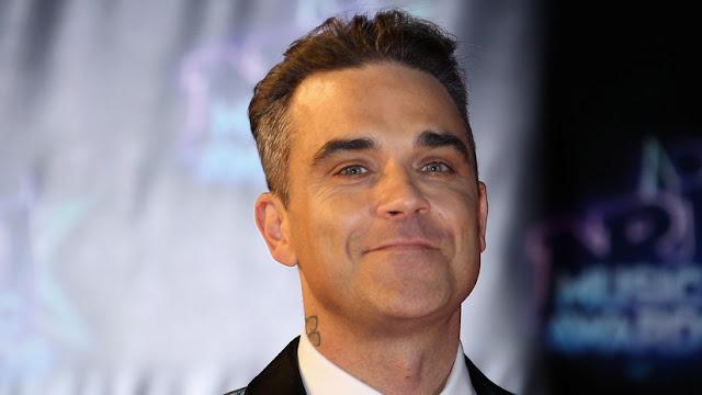 Robbie Williams confiesa que tiene un guardaespaldas que lo protege de los ovnis las 24 horas del día