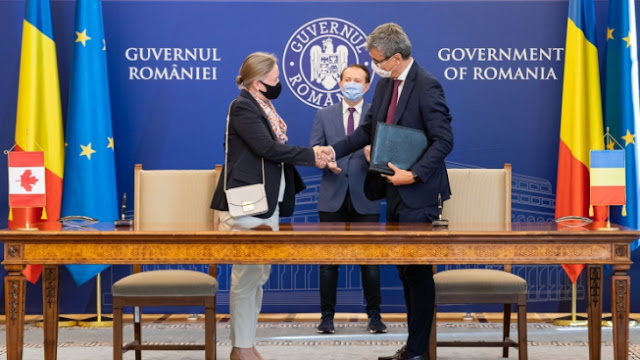 Romanian minister of mineral resources Virgin Popescu and Canadian Ambassador to Romania Annick Goulet shake hands following the signing of the MoU (Image: Romanian energy ministry)
