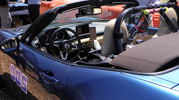 Blue Metallic Miata with Tan Interior and Many Customizations