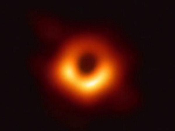 An image of the supermassive black hole M87 that was taken by the Event Horizon Telescope Collaboration...using 8 radio telescope observatories located around the world in April of 2017.
