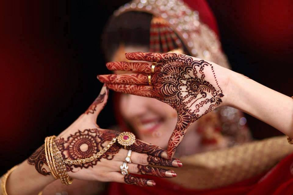 Indians Applying Mehendi/Henna On The Hand And Feet