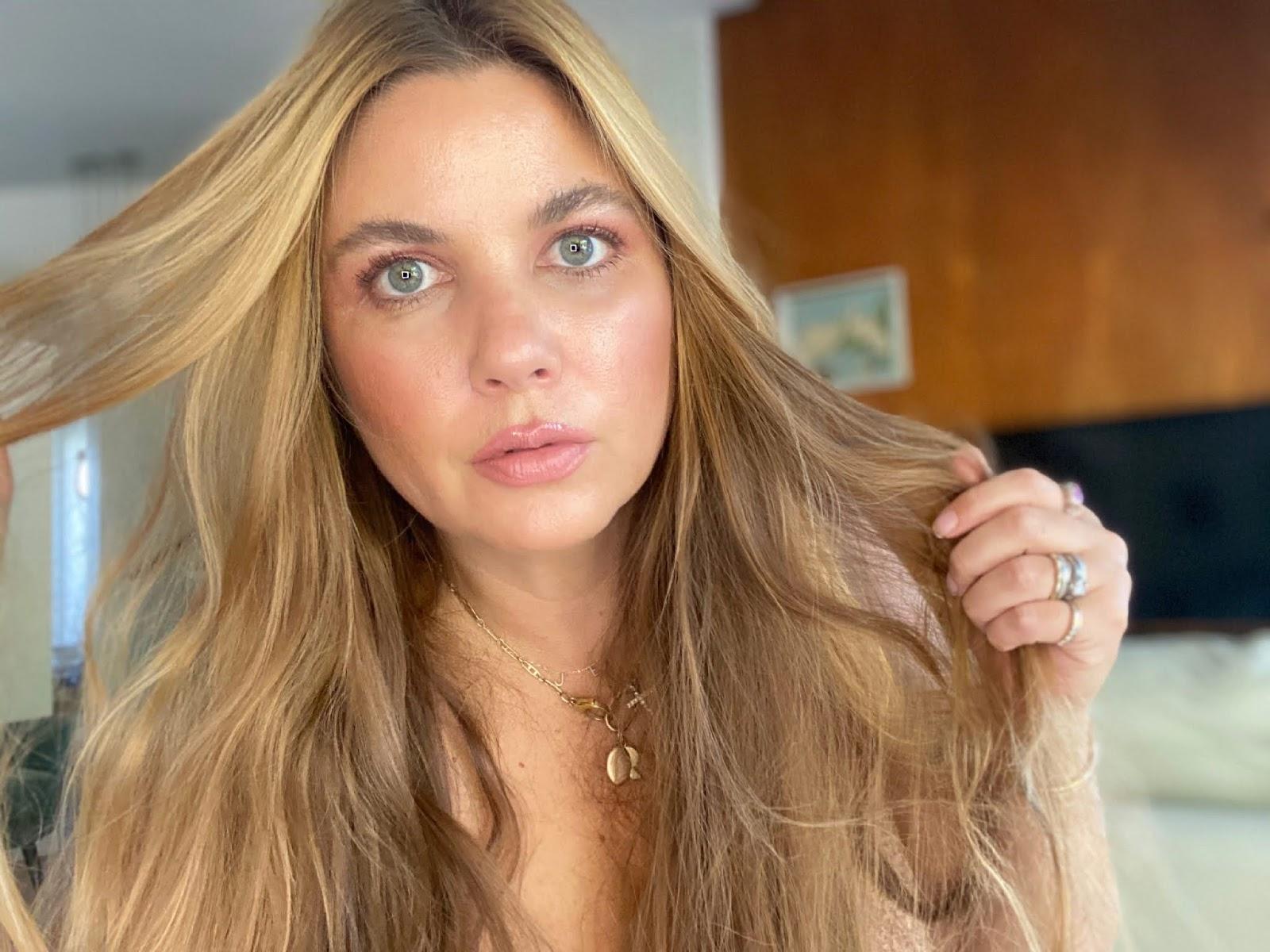 woman showing makeup