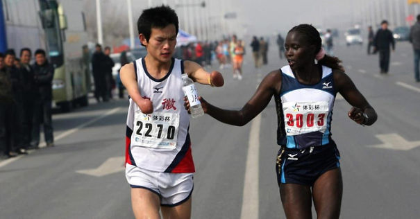 Jacqueline Kiplimo helps a disabled runner finish a marathon in Taiwan, costing her a first place finish.