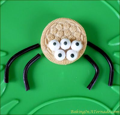 Spider for Spider in his Web Cake: cake, a web and a spider peeking through. Yup, it's October! | Recipe developed by www.BakingInATornado.com | #Halloween #cake