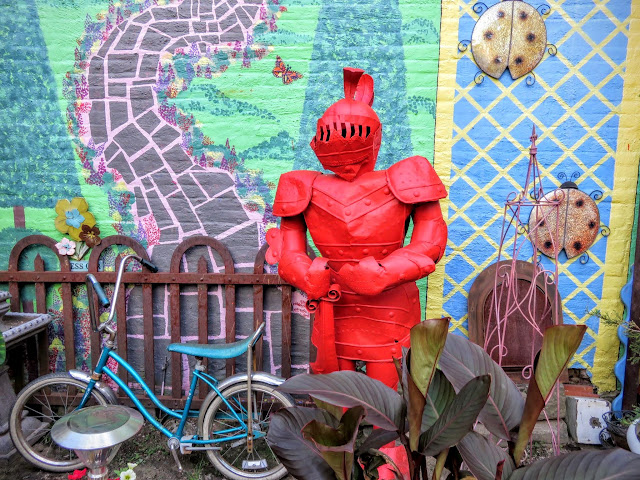 Suit of armor painted red at Randyland in the Mexican War Streets neighborhood of Pittsburgh