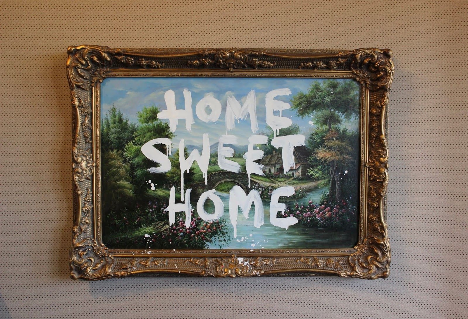 A 'Home sweet Home' banksy print in Moco Museum