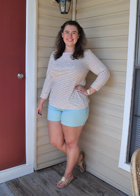 a woman wearing a striped tee, shorts, sandals, and a watch inspired from Pinterest