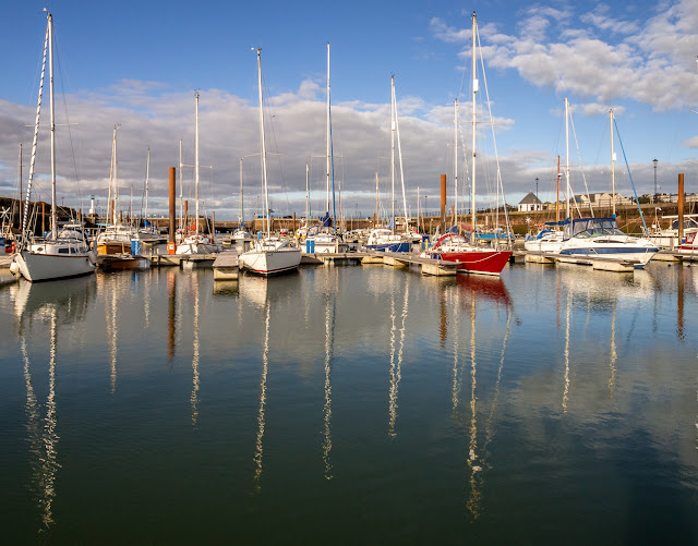 Photo of reflections in the calm water at Maryport Marina last Friday