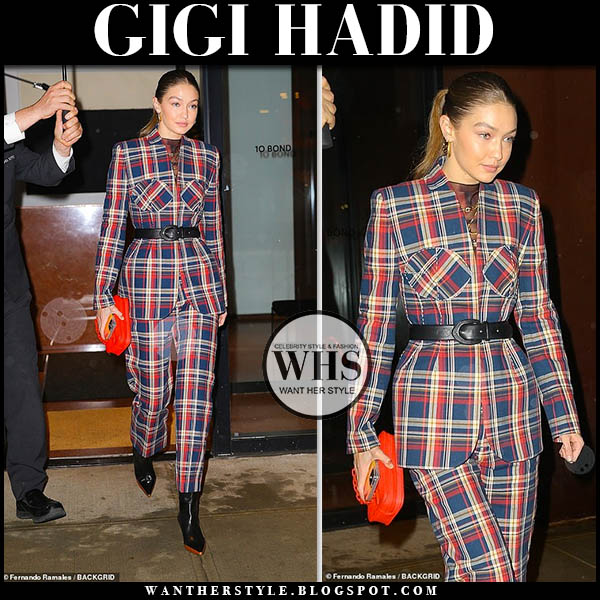 Gigi Hadid in red and blue esau yori plaid suit and black wandler boots. celebrity style december 13