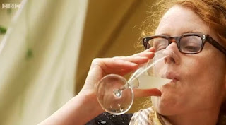 Alys drinks a glass of homemade elderflower champagne
