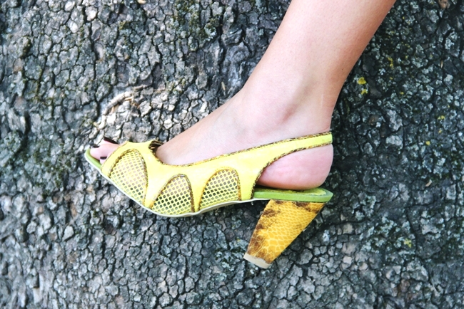 Yellow mesh sandals witrh snakeskin heel.