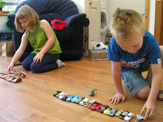 lining up toy cars on conservatory floor