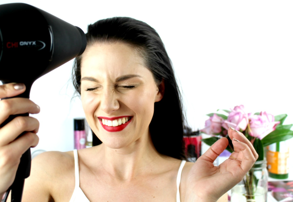 This is a photo of the Chi Onyx Euroshine in my hand, as I use it to blowdry my own hair. I look quite happy with glee as the hair whips away from my face.