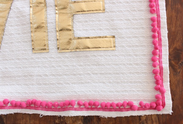sew pom pom trim to pillow front