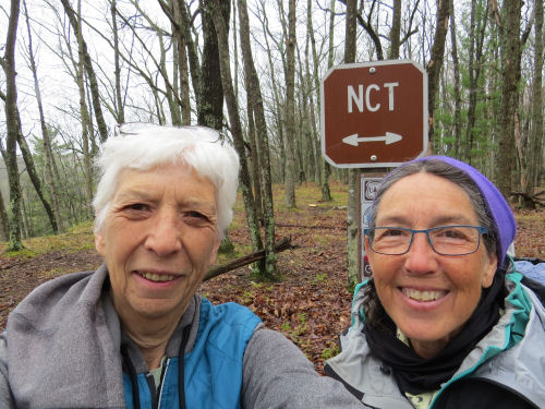 two people at a North Coutry Trail sign