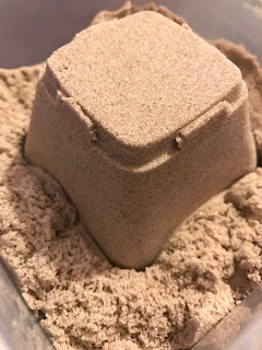 A simple sand castle made with kinetic sand