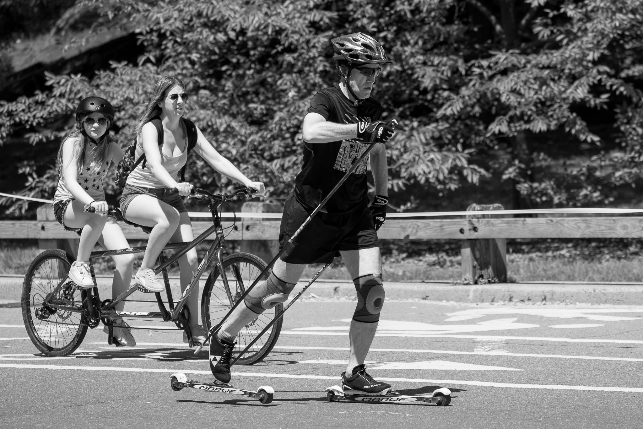 a black and white photo of people exercising in central park