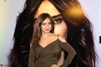Neha Sharma Pos At Mobile App Launch 10.jpg