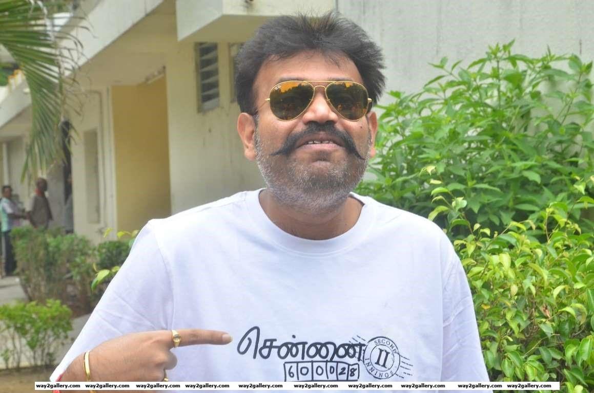 Premgi Amaren poses for photographers during a press meet of Tamil film Chennai  II