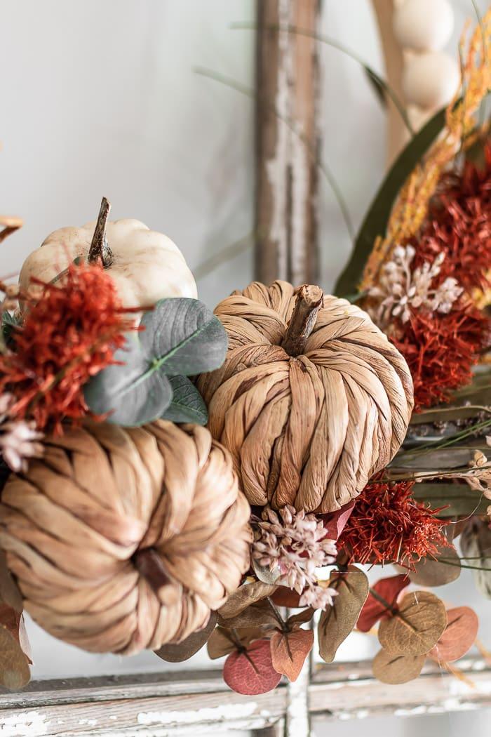 close up of pumpkin on Fall wreath