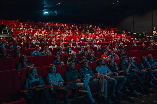 People sat in a cinema watching a film