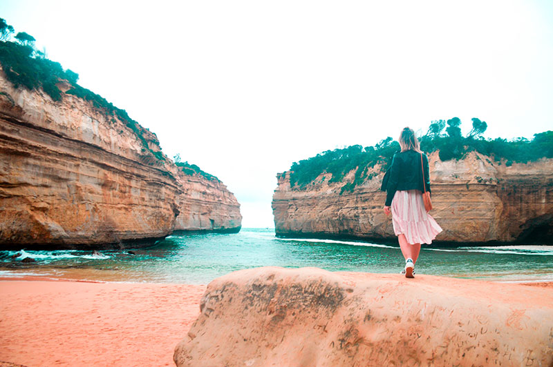 fashion travel blogger girl in loch ard gorge beach great ocean road victoria