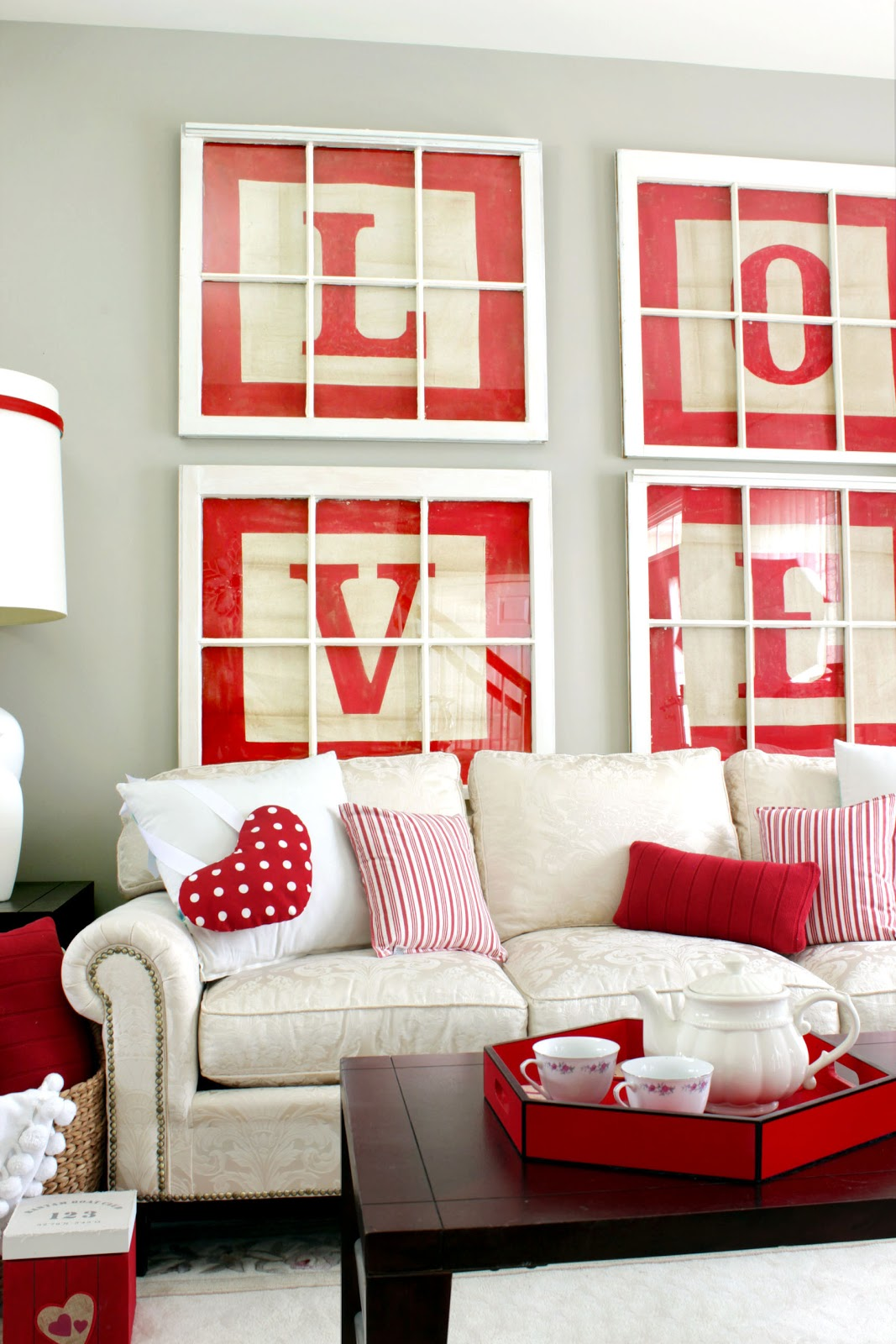 Living room decorated for Valentines with Love wall art and lots of red
