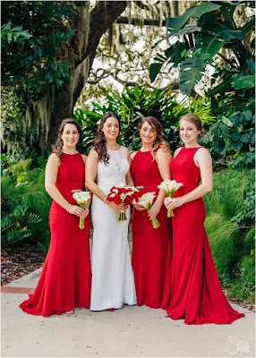 bridesmaids in long red dresses