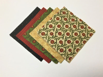 A co-ordinating group of five inch Charm Squares