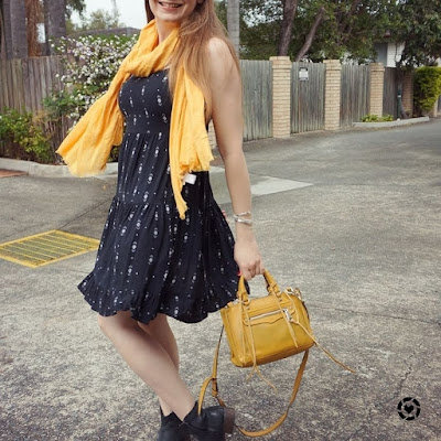 awayfromtheblue instagram | twirling in tiered black strappy sundress mustard scarf and bag