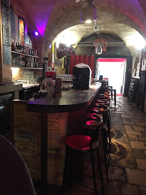 The front part of the Bar de Boucher in Bordeaux, with a wooden bar and bar stools