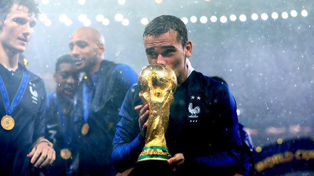 Antoine Griezmann Sealed 2018 FIFA World Cup Trophy with a kiss.