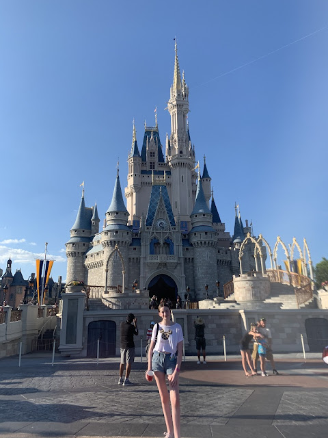 teen in front of Disney castle