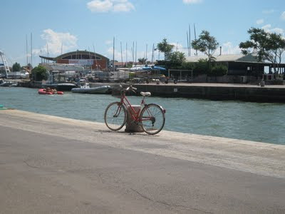 Bicycle and boats at Castliglione della Pescaia's harbor