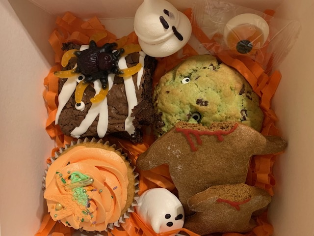 Halloween themed treat box of biscuits and cakes